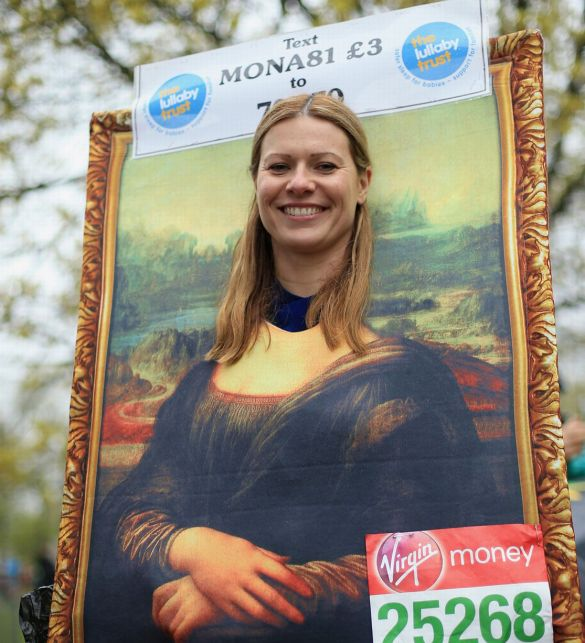 A-runner-poses-for-a-photograph-before-the-Virgin-Money-London-Marathon-2