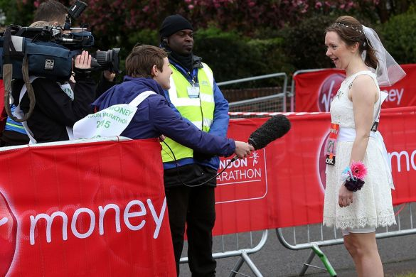 A-woman-who-plans-to-be-married-half-way-through-the-race-is-interviewed-by-the-start-line-of-the-London-Marathon